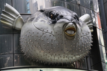 The fugu puffer fish facade in front of a restaurant.