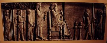 A relief from the treasury courtyards of Persepolis.  Maybe the Persians did view Xerxes as a god?Consider the scale of the servants to Xerxes himself.