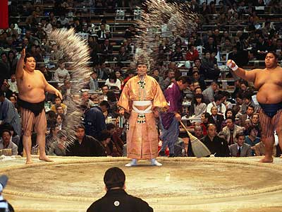Sumo throw salt to purify the ring of evil.