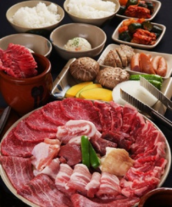 An assortment of common Yakiniku ingrediants; various cuts of beef and pork,  chicken and vegetables.