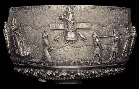 Zoroastrian silver bowl with Zoroastrian symbol in the middle.