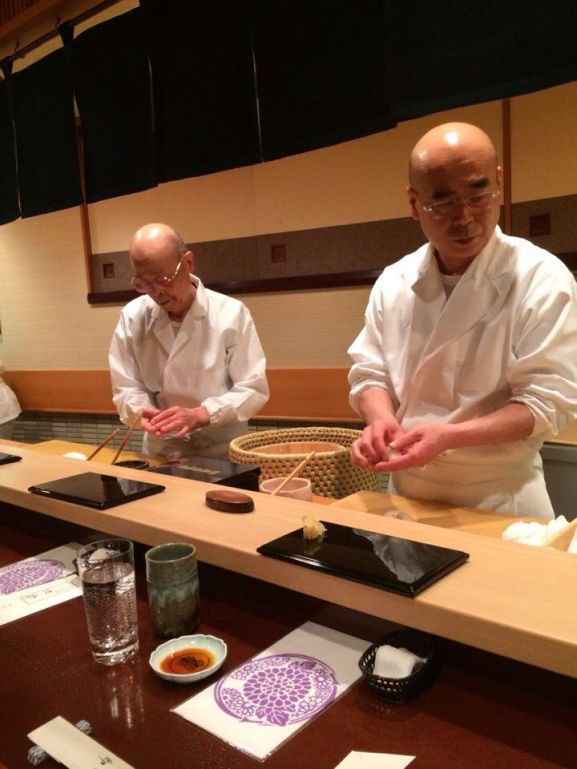 Jiro Ono and his son at their sushi restaurant Sukiyabashi Jiro, Ginza.  President Obama famously made a visit to the 3-Michelin star restaurant in 2014.