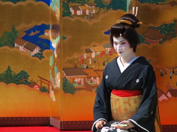 Asakusa Geisha.  Word to the wise: it's popular for foreigners and Japanese alike to stride around dressed as Geisha.  The true sort aren't so quick to take a picture with you.