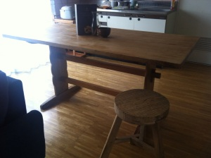 A rustic dining table and stool from Silk in my apartment.